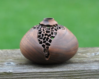 "320 Hand carved and pierced walnut hollow form (4.5"" x 3.0"")."