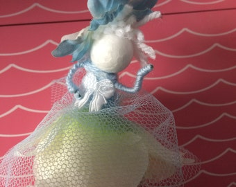 Blue and white ribbon flower fairy