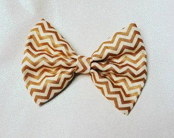 Gold chevron bow