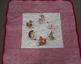 Woodland Picnic Party Quilt. Six machine embroidered animals are ready to have a picnic. Coordinating bib for your child is included.