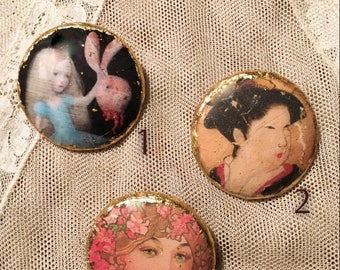 Wooden and gold leaf brooches.