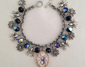 Silver tone Gothic Spiders and Webs charm bracelet with faceted Czech glass beads