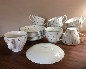 Teacups and Saucers by Johnsons Bros