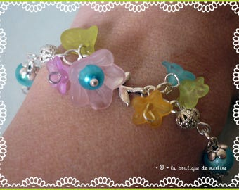Costume jewelry: adornment bracelet and turquoise beaded earrings and lucite flowers
