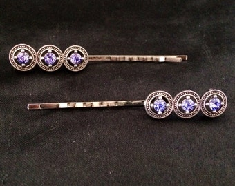 Set Of 2 Silver Metal Hair Pins Featuring Circular Ornaments With Purple Jewels
