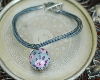 Charm bracelet with hand painted ceramic bead