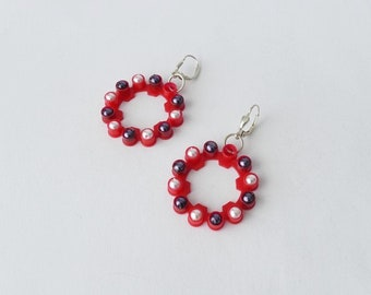 Bright red earrings made of plastic and sterling silver