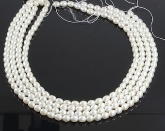 1 Strand, 6x8mm Fresh Water Pearl, Rice Pearl Bead, White Natural Pearl, 15.7 inches Strand, approx 52 beads per strand