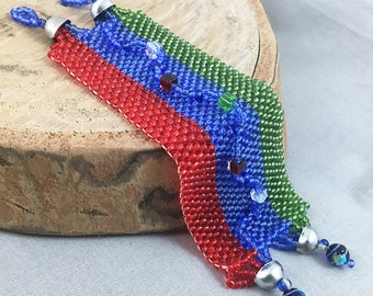 Red, blue and green seed bead woven bracelet, beaded jewellery
