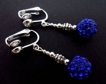 A pair of pretty aqua blue shamballa style dangly clip on earrings.