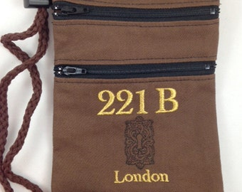 A convention necessity! Embroidered Sherlock lanyard/purse with adjustable cordlock