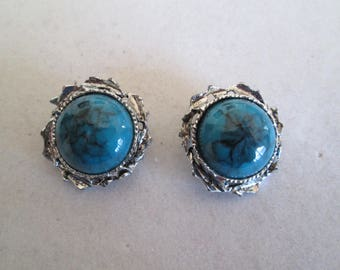 1980's southwestern style silver conch clip on earrings with faux turquoise centers