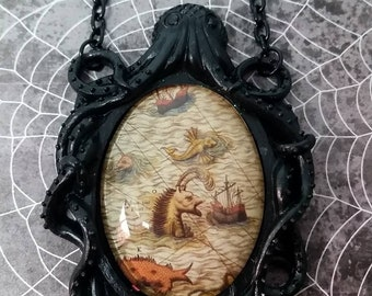 Black Octopus pendant with Vintage SeaMonster behind Glass Necklace