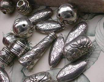 set of 17 large resin beads plated silver 15mm to 40mm