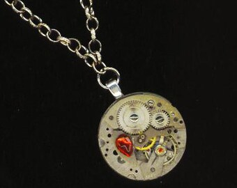 Steampunk  Vintage Watch Necklace . Jewel Watch Movement . Bold Rubies Steam Punk Jewelry - Time is Precious by enchantedbeas on Etsy