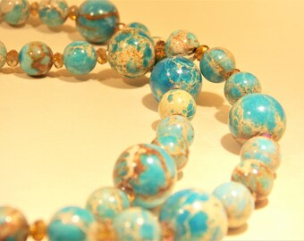 Long semi precious stone necklace in blue and tan with matching earrings