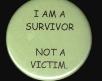 I am a survivor not a victim.   Pinback button or magnet