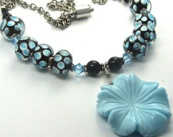 NECKLACE ~ Baby blue black lamp work beads black onyx ~  Swarovski crystals ~ carved blue flower