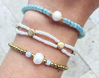 Stapelen van kralen armbanden