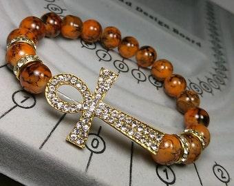 Gold Ankh Charm with Orange Marble Bracelet