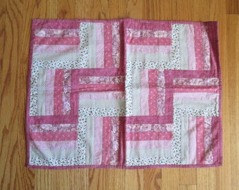 "Hand quilted vintage pink log csbin pattern table topper measures 19"" x 25"""