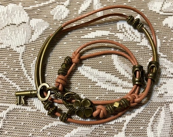 Light Salmon Color, Leather Bracelet With Lobster Claw Clasp.  It Has Antique Bronze Tone Beads.