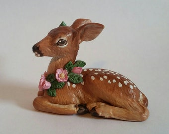 Fawn with wild roses