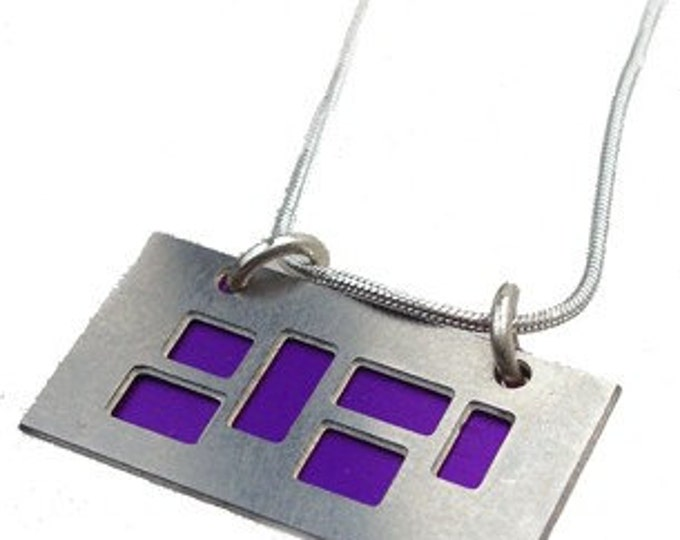 silver pendant with Purple and jet cutouts