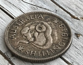 1943 Australian Shilling, collectable coin. Condition is used.