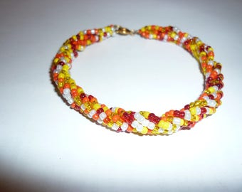 Beaded with seed beads in shades of Orange bracelet