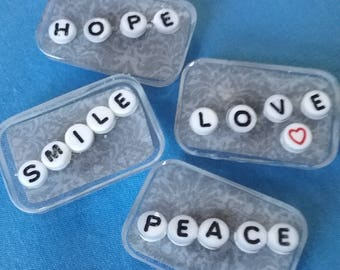 Set of 4 worded resin magnets.