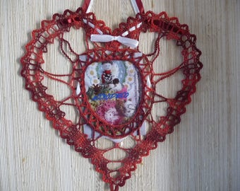 Hand made crochet red burgundy ombre heart shaped doily.