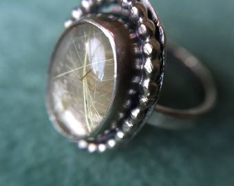 Handmade golden rutilated quartz sterling silver ring.