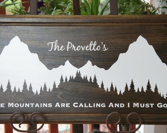 Personalize Cabin family name wall wood plaque sign - The Mountains Are Calling and I Must Go.Wedding Registry Dark stain with vinyl 22x11