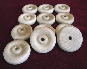 12  Hardwood  Wheels  1-3/4 inch diameter with 1/4 hole  unfinished