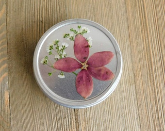 Purple flower tin with mystery set of stitch markers