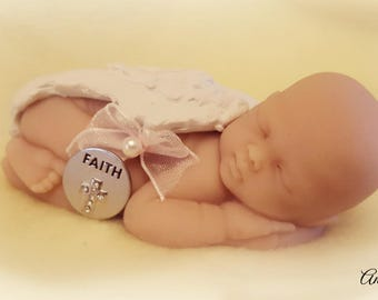 Sleeping Angel Baby with Faith token and bow