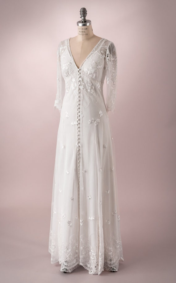 Wedding Gown of embroidered tulle with buttons up the front