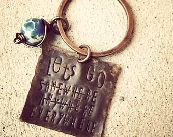 Wanderlust keychain, travel quote