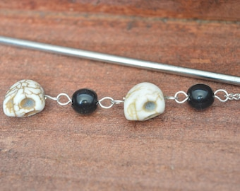 Bookmark - sting hair in plated silver skulls