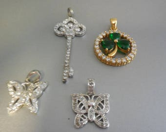 Lot of Four Charms