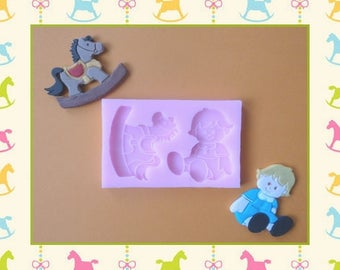 Silicone mold: rocking horse and girl.