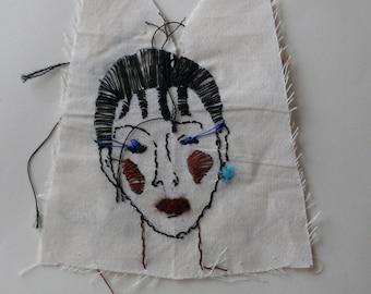 Blue eyelash lady embroidered drawing