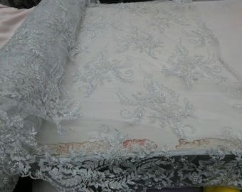Supreme Fortune bridal wedding beaded mesh white fabric lace. Sold by the yard.