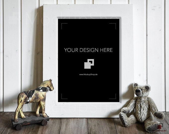 5x7 PHOTOFRAME NURSERY MOCKUP with wooden horse and brown bear in front of the Photo Frame. Perfect mockup frame for kidsroom