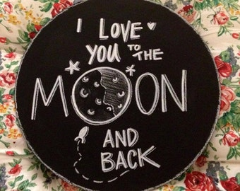 I love you to the Moon and back prop sign.