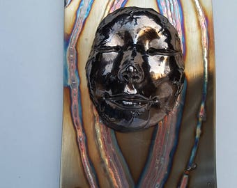 Takes the Sun and Moon stainless steel and clay face wall art