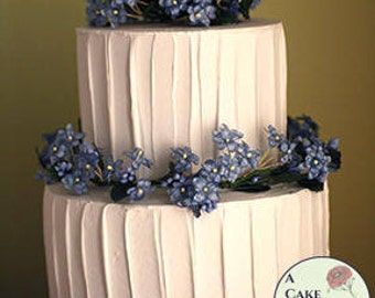 "Fake cake with rustic icing for home staging, dessert buffet decor, and wedding centerpieces. 5"" and 7"" tiers, two tiered faux cake."