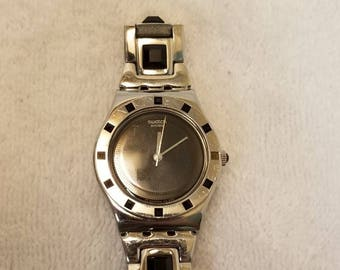 Swatch Nuit Sauvage YLS155G Swiss Black Dial Black Stones Two Tone womens new battery