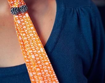 Skinny Tie- Orange Loops print